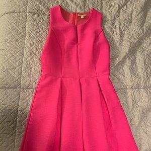 Hot pink pleated mini dress.